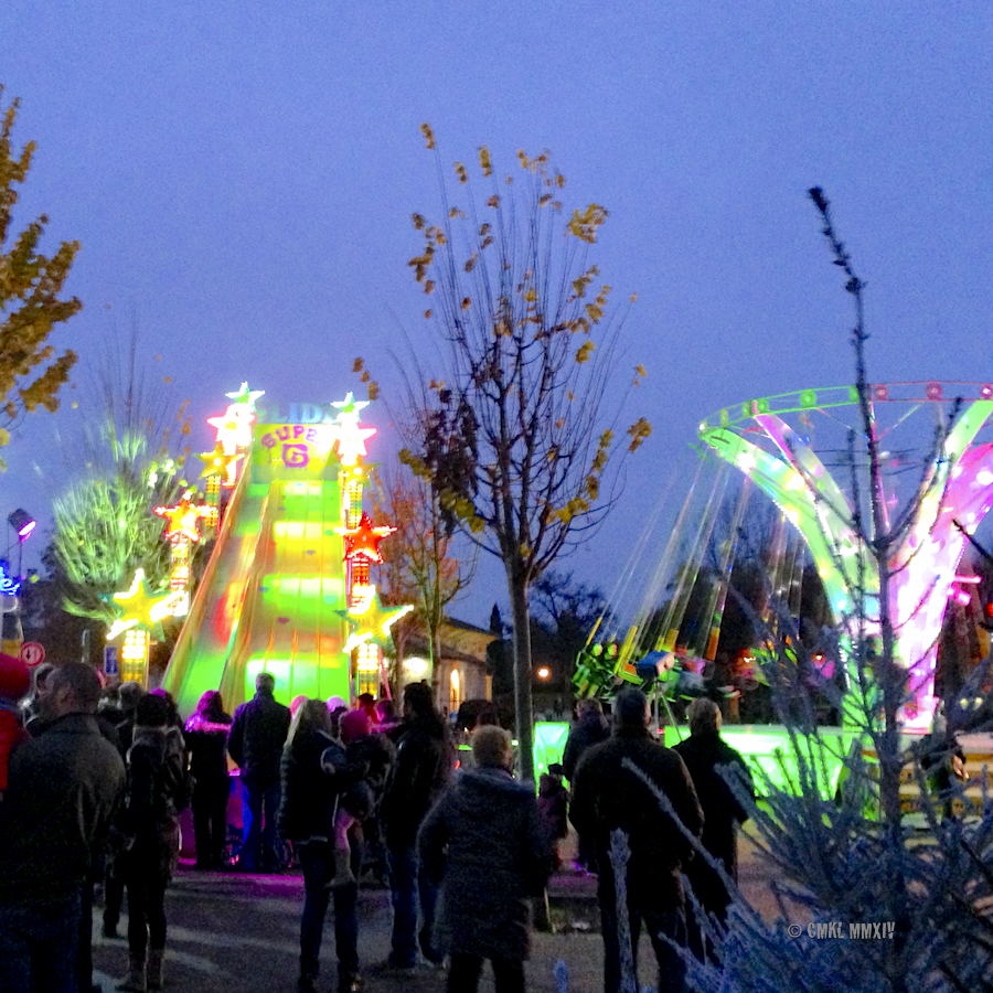 Crowds clustering at the rides, ...