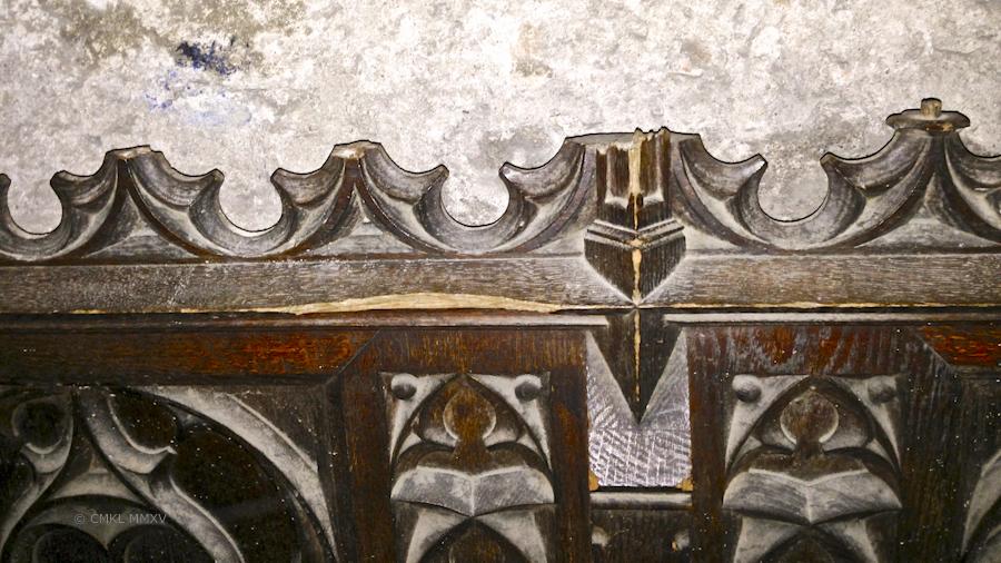carved panels resting rendomly against walls