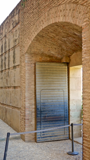 Through this metal-clad gate do you enter the ancient fortifications protecting Granada.