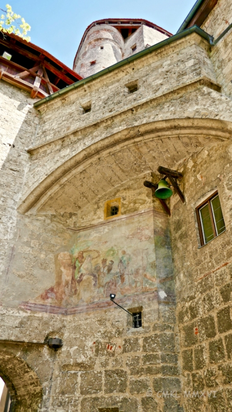 A faintly visible 16th fresco and a bell to ring the hours of the watch for the garrison.