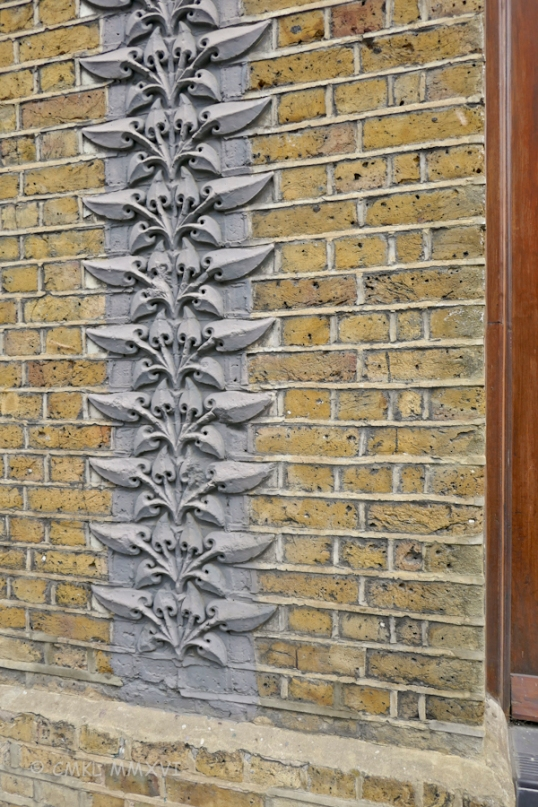 Detail on the façade of the Shoemaker buidling. Formerly a shoe factory, now loft appartments