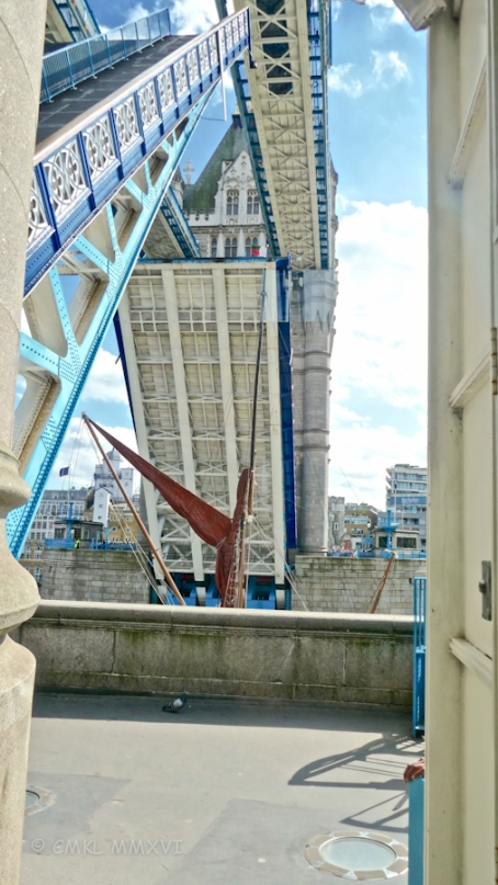 "Watching the Thames sailing barge ""Thistle"" pass through the raised bascules."