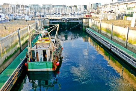 "Coming home, the ""Petite Follie"" fishing boat waits patiently in the lock for the water to rise to Sutton Harbour levels."