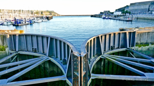 The lock gates are closed against the low tide in the Plymouth Sound breakwater.
