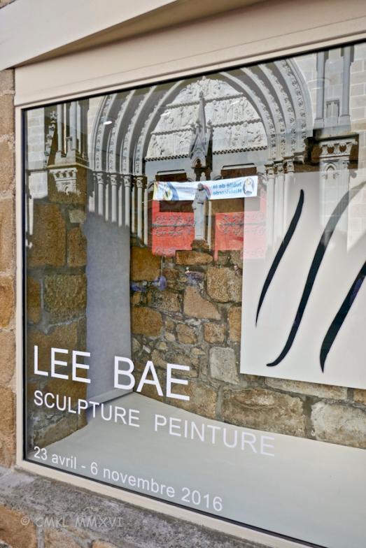 La Cohue – Musée des Beaux-Arts à Vannes. Reflection of the main doors of la cathédrale Saint-Pierre across the street in the museum window.