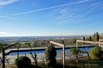 The terrace is elevated over the pool which in turn is elevated above the vineyard. All of it overlooking Bordeaux!