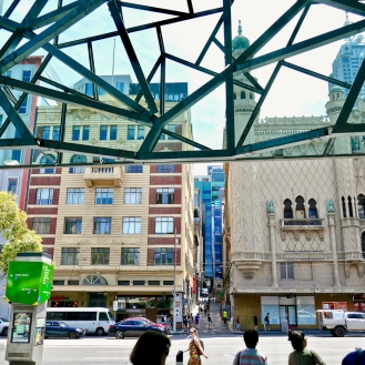 Looking out over Flinders street toward more traditional Melbourne architecture