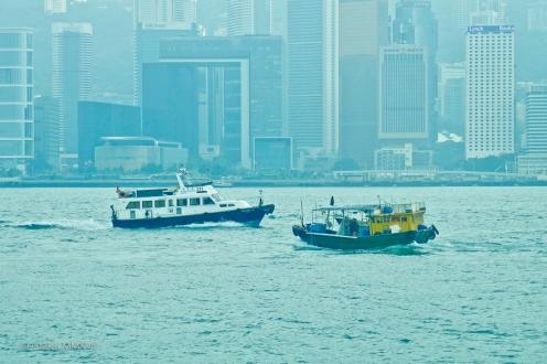 Crossing path, harbor police versus junk.
