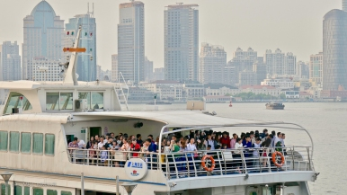 A crowded ferry to Pudong on the opposite bank.